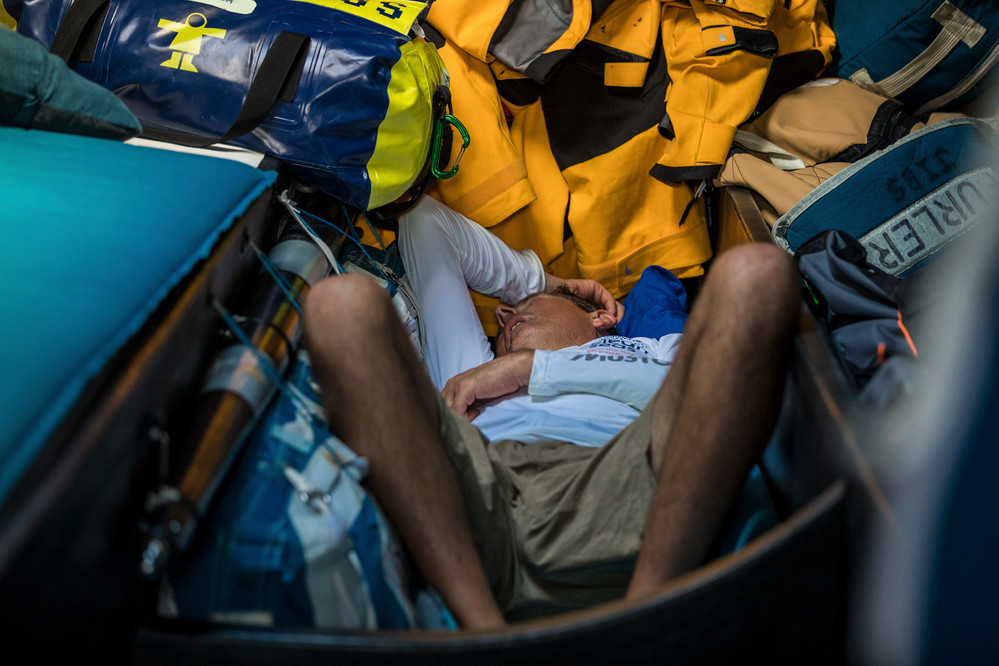 Leg 4, Melbourne to Hong Kong, day 9 on board Turn the Tide on Plastic. Brian Thompson grabs a midday nap from the soaring heat of the sun. Photo by Brian Carlin/Volvo Ocean Race. 10 January, 2018.