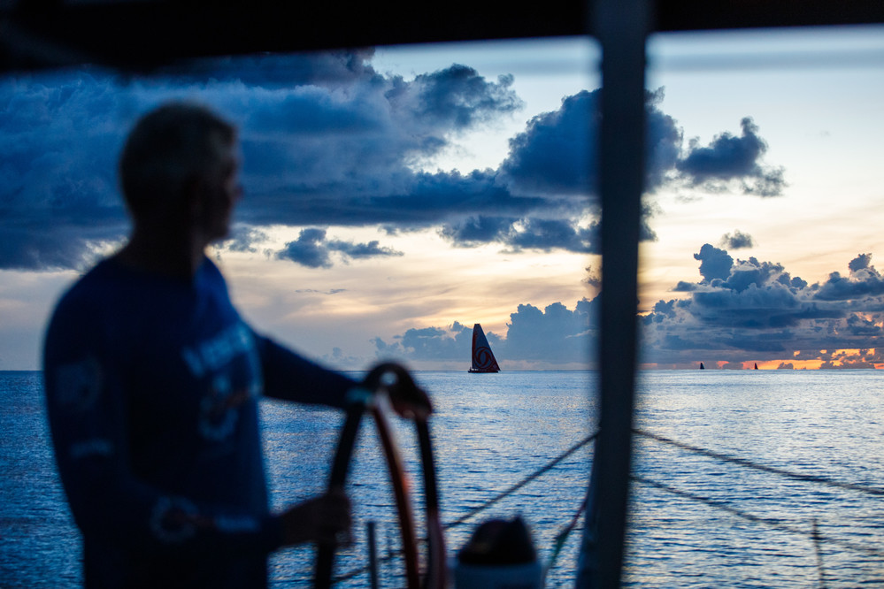 Leg 4, Melbourne to Hong Kong, day 09, Tony Mutter eyes the competition at sunset, all lined up after nine days of sailing on board Vestas 11th Hour. Photo by Amory Ross/Volvo Ocean Race. 10 January, 2018.
